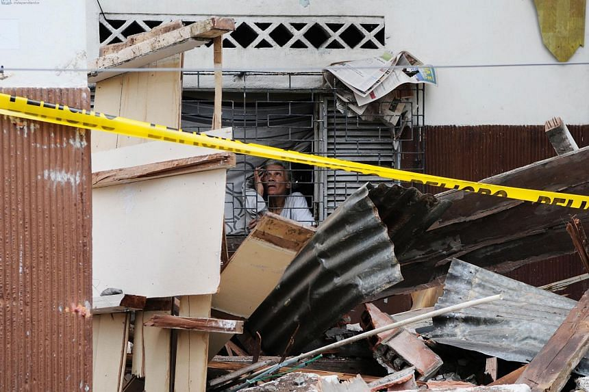 An elderly woman inside her partially destroyed home on April 17, 2016 in the city of Guayaquil, Ecuador, which was by a 7.8-magnitude earthquake.