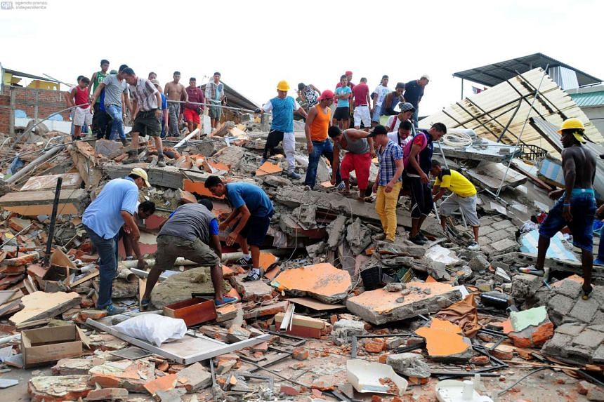 Local residents and rescue workers in the city of Manta in Manabi province searching through the rubble on April 17, 2016, for survivors of the 7.8-magnitude quake that hit Ecuador.