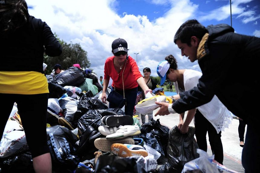 People collecting shoes and clothes for the victims in Quito after a 7.8 degree earthquake hit Ecuador.