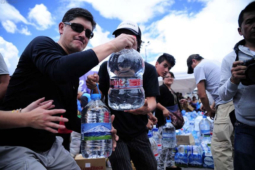 People collecting food and water for the victims in Quito after a 7.8 degree earthquake hit Ecuador.