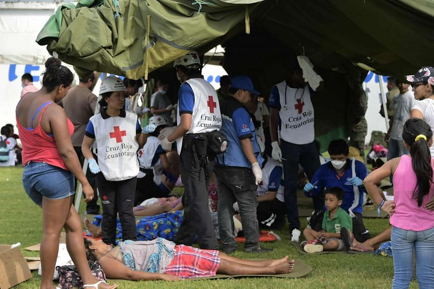 A Red Cross station treating survivors of the 7.8-magnitude quake that hit the city of Pedernales, Ecuador the day before, on April 17, 2016 .