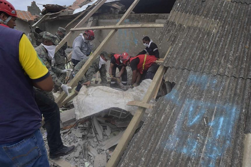 Rescuers searching for victims under the rubble in Pedernales, Ecuador, on April 17, 2016 a day after a 7.8-magnitude quake hit the country.