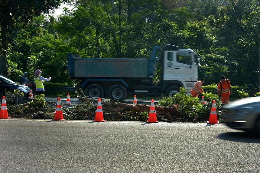 Workers cleaning up the area where the cement mixer truck overturned.