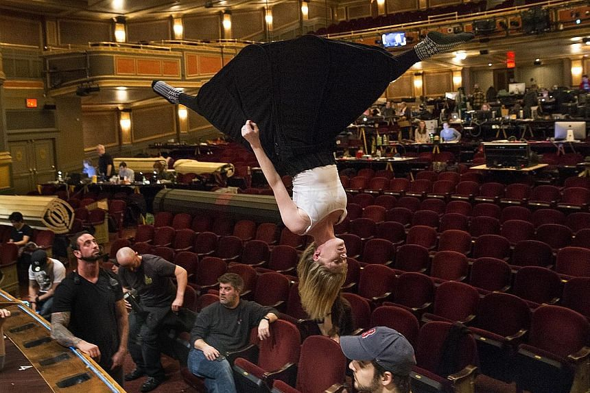 Performer Ruby Lewis goes heels over head during a rehearsal for Paramour, a $34-million Cirque de Soleil production.