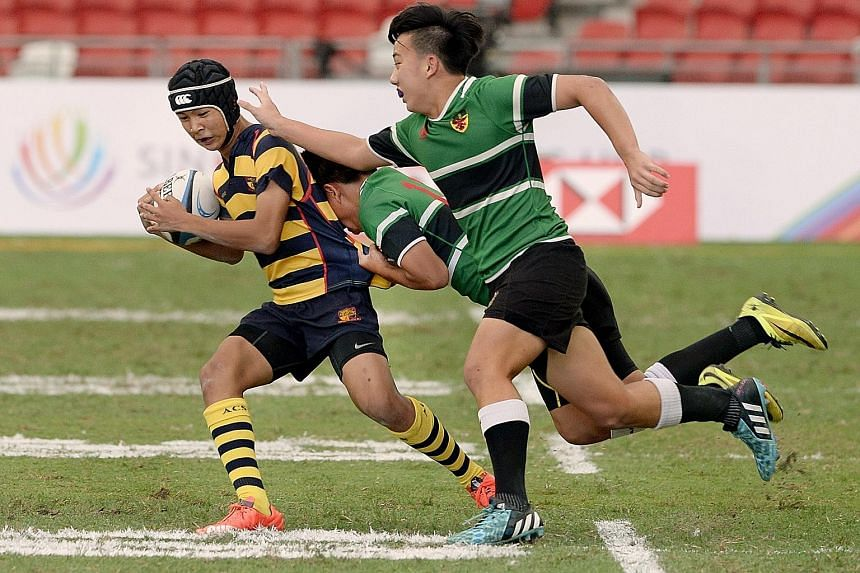 ACS(I) vice-captain Matthew Lim breaking away to score his first of two tries. ACS(I) came from behind to beat RI 14-12 at the National Stadium.