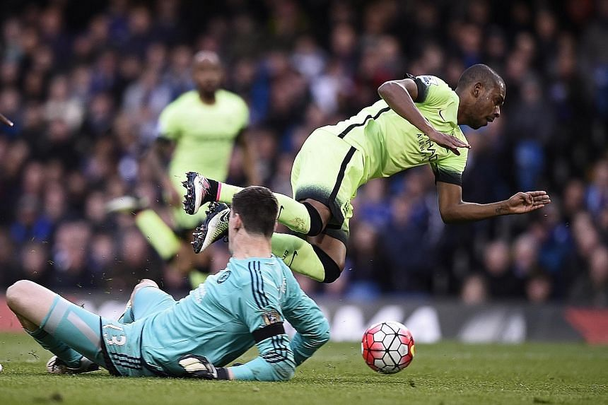 Hat-trick scorer Sergio Aguero converted the penalty that resulted from Chelsea's Thibaut Courtois being given a red card after this foul on Manchester City's Fernandinho.