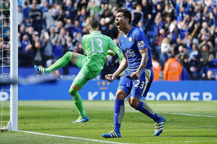 Leonardo Ulloa celebrating after scoring the last-gasp equaliser for Leicester from the penalty spot in the 2-2 draw against West Ham at the King Power Stadium yesterday.
