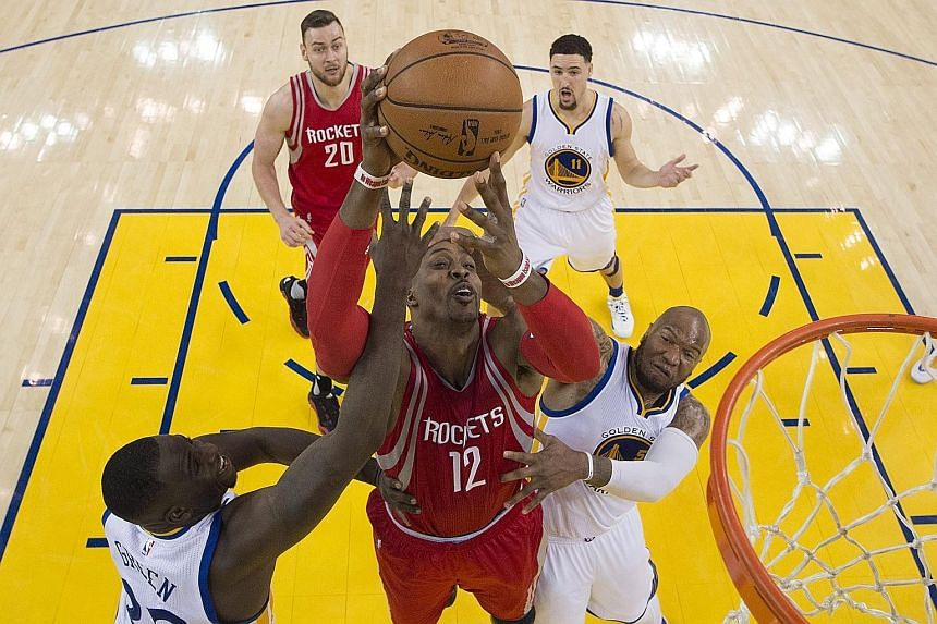 Houston Rockets centre Dwight Howard shooting over Golden State Warriors forward Harrison Barnes (left) and centre Marreese Speights during Game One of the NBA Western Conference play-offs in Oakland. The Warriors' versatility was clearly evident in