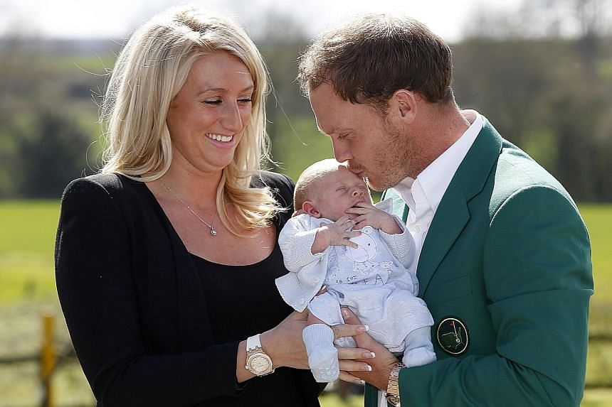 US Masters champion Danny Willett with his wife Nicole and two-week-old son Zachariah at Lindrick Golf Club in Yorkshire last week.