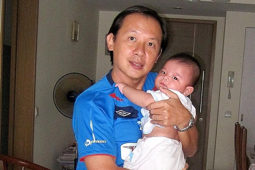 Mr Khoo in a photo taken two years ago with his son, Kevin. The English language tutor writes on issues such as education, the cost of living and perceived injustices.