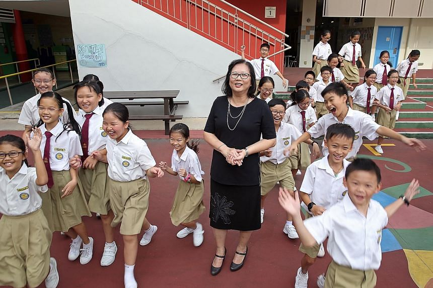 "Madam Poh with her Primary 5 class at Yu Neng Primary School. She believes in being flexible in the approach she takes towards individual pupils as every child is different, with different needs. She once allowed a ""problem child"" to leave the classr"