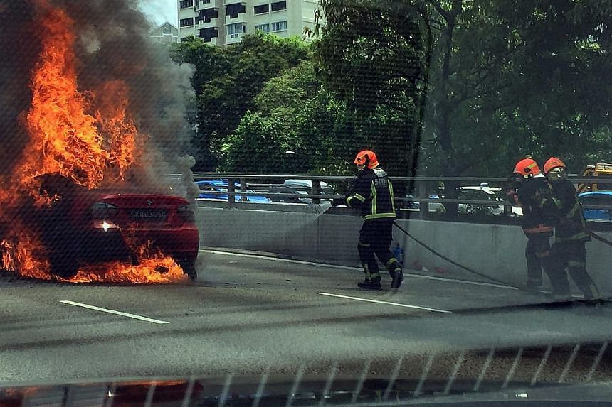 SCDF firefighters putting out the fire, which broke out on the CTE at about 1pm.