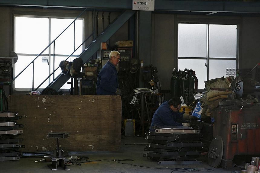 A metal processing factory in Tokyo. There is speculation that the Bank of Japan, which meets next week, will unveil more stimulus measures to boost the country's stalling growth.