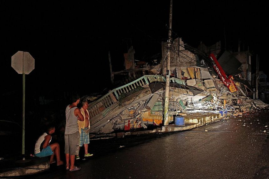 """A collapsed building in Pedernales town, Ecuador, yesterday. The town's mayor described the 7.8-magnitude earthquake that struck the country as catastrophic, with some villages """"totally devastated""""."""