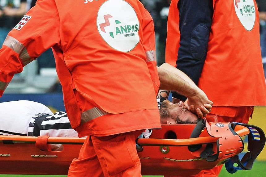 Juventus' Italian midfielder Claudio Marchisio being carried off on a stretcher after being injured during the Italian Serie A football match.