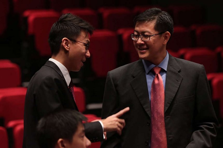 Lawyer Mr Choo Zheng Xi (left) speaks with Mr Eugene Tan (right) at the Supreme Court auditorium.
