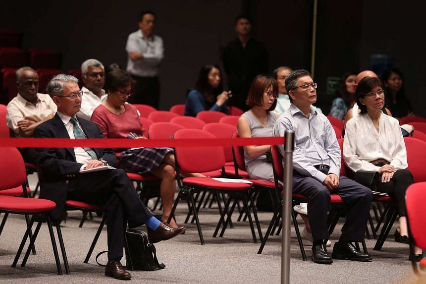 Mr Tan Jee Say (second from right) attends the first day of the public hearing on April 18, 2016.