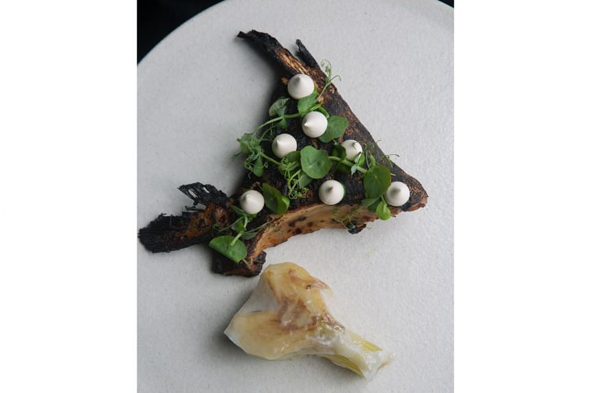 5TH QUARTER: Charcoal-black Hamachi collar (S$28) with soy meringue and fennel.