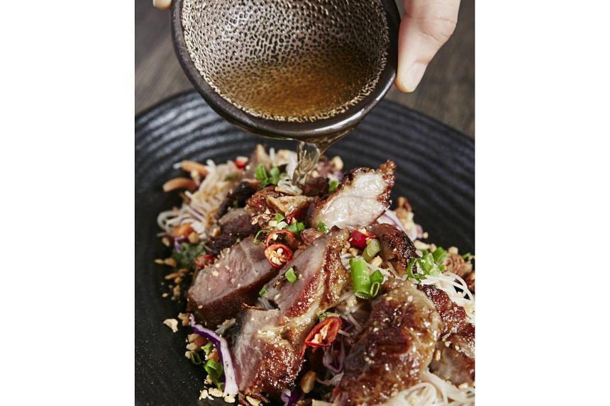 FAT SAIGON BOY: The signature grilled lemongrass pork with vermicelli.
