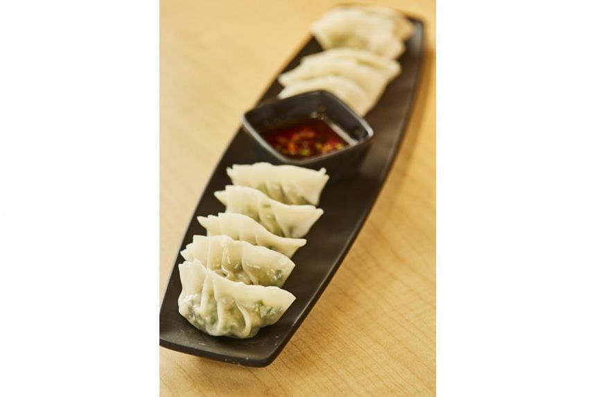 TANG RESTAURANT AND BAR: Homemade dumplings (above) with pork, shrimp, and chives (S$6 for 4),