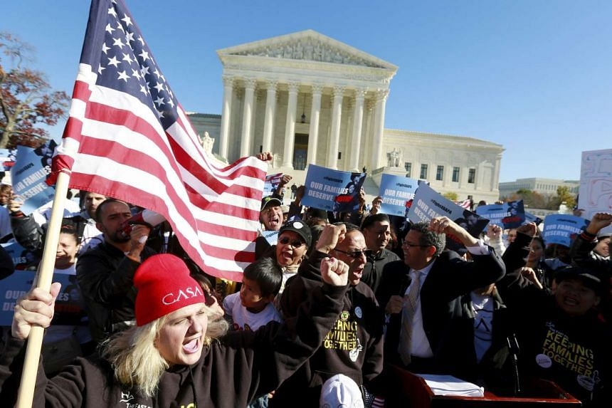 Immigrants and community leaders rally in front of the US Supreme Court to mark the one-year anniversary of President Barack Obama's executive orders on immigration in Washington, in this file photo taken on Nov 20, 2015.