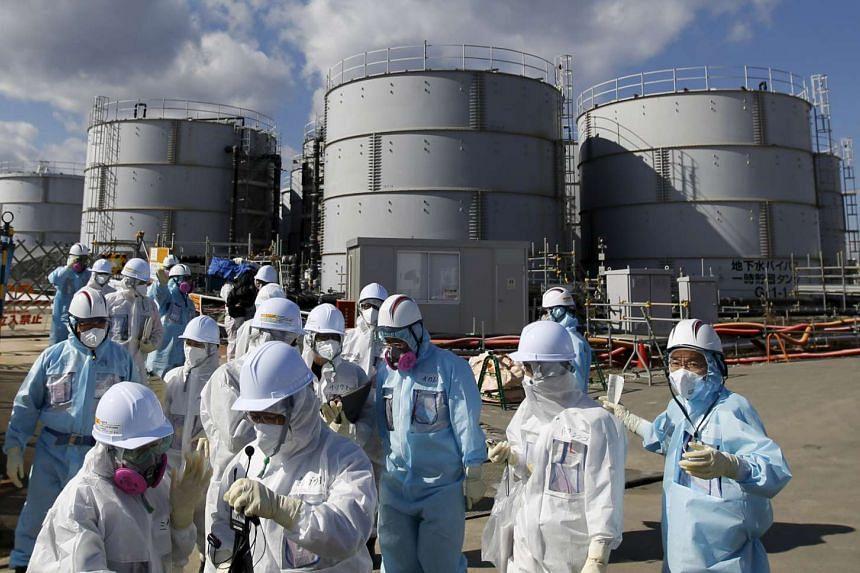 Members of the media at TEPCO's tsunami-crippled Fukushima Daiichi nuclear power plant in Fukushima prefecture, on Feb 10, 2016.