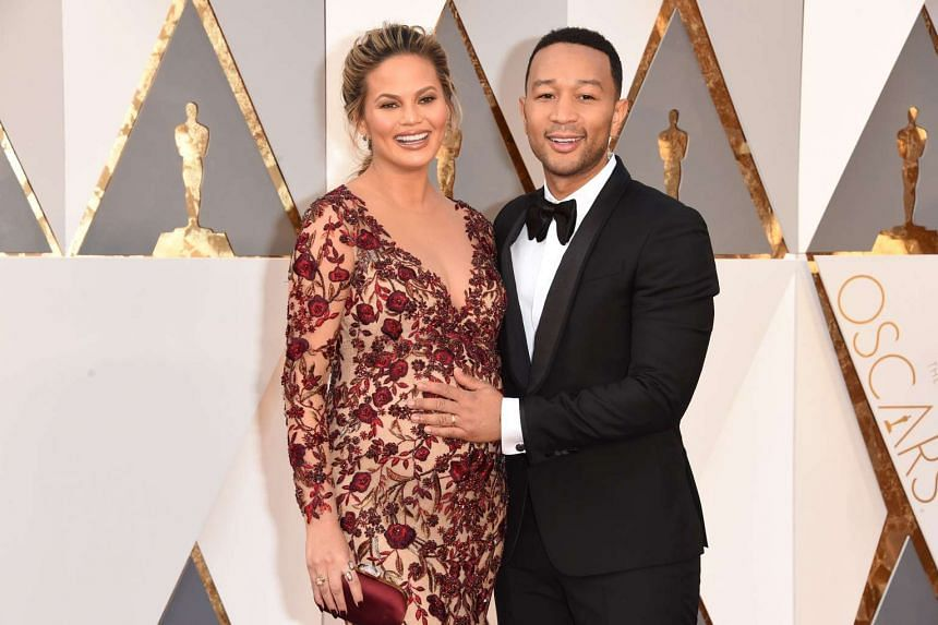 Model Chrissy Teigen (left) and recording artist John Legend at the 88th Annual Academy Awards, on Feb 28, 2016.