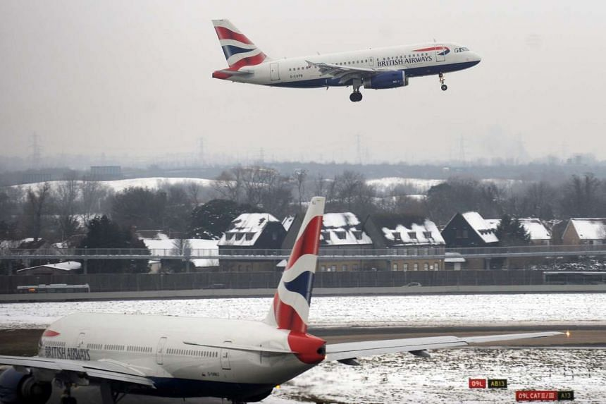 A file photograph shows a British Airways aircraft landing at Heathrow Airport in London.