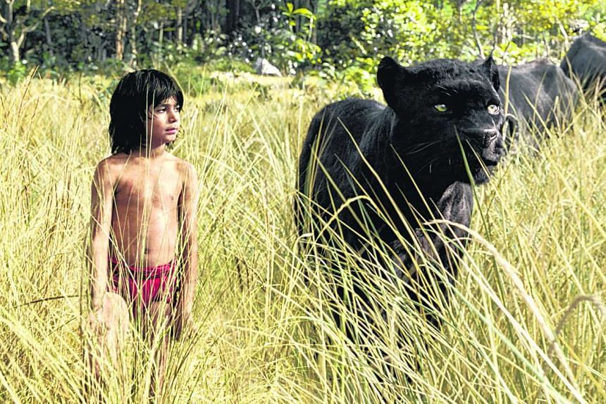 Neel Sethi as Mowgli talks with  Bagheera the panther  voiced by Ben Kingsley in The Jungle Book.