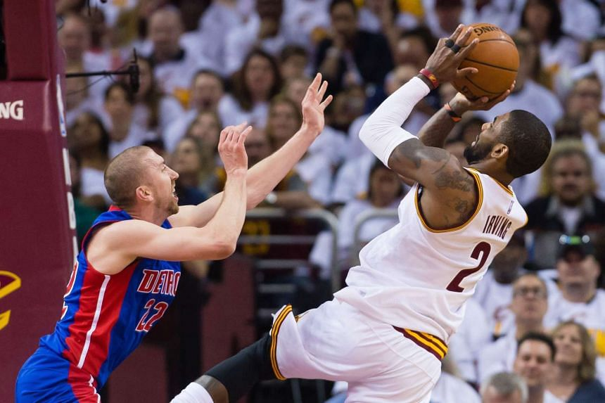 Kyrie Irving #2 of the Cleveland Cavaliers shoots over Steve Blake #22 of the Detroit Pistons during the first half of the NBA Eastern Conference Quarterfinals in Cleveland on Sunday.