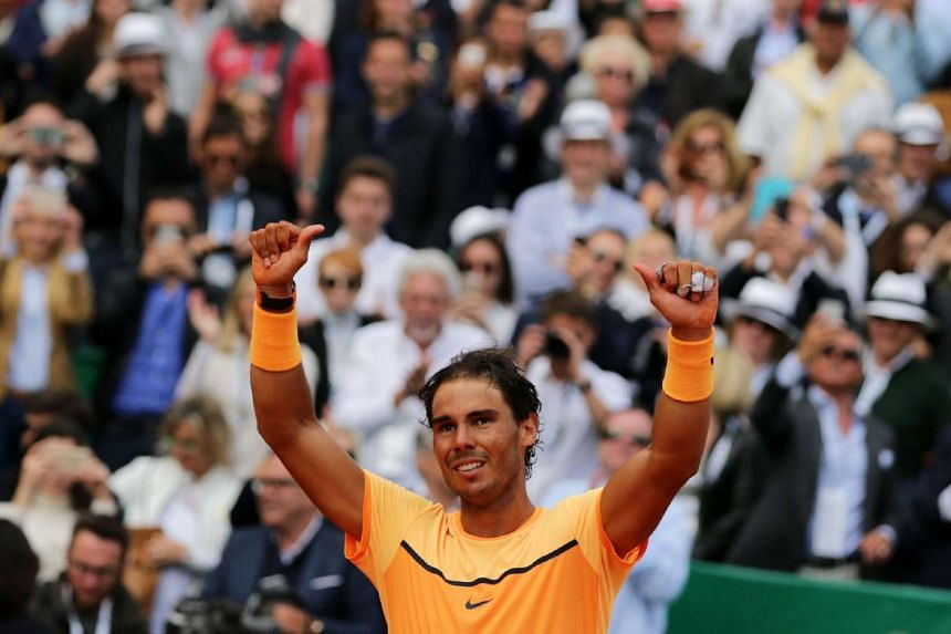 Spain's Rafael Nadal celebrates after winning the Monte-Carlo ATP Masters Series Tournament on Sunday.