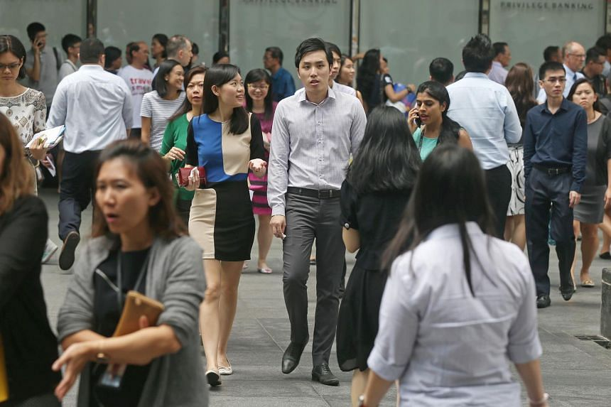 Office workers outside Raffles Place MRT station during lunch time.