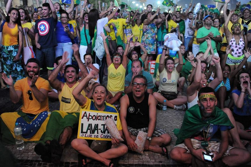 Supporters of impeachment of Brazilian President Dilma Rousseff watch big screens on April 18, 2016,  as lawmakers vote on whether the impeachment should proceed.