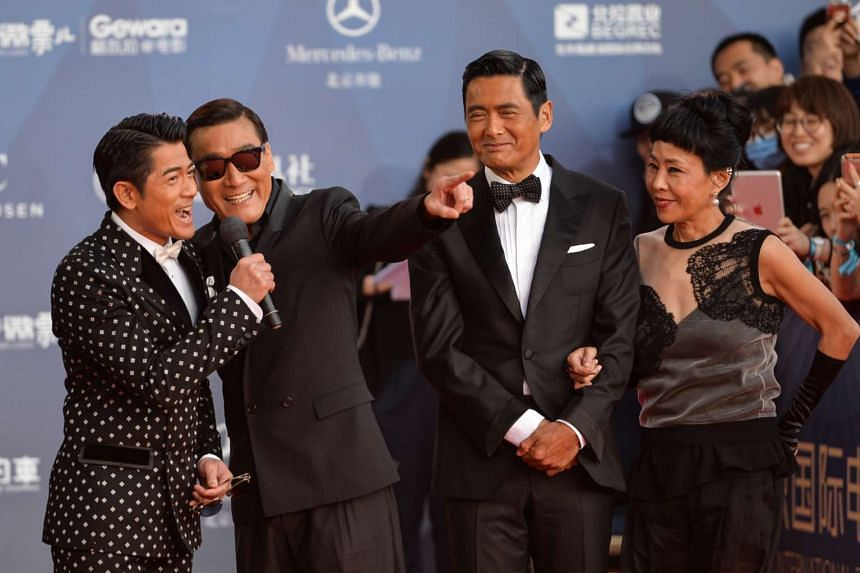 Hong Kong stars (from far left) Aaron Kwok, Tony Leung Ka Fai and Chow Yun Fat with his wife Jasmine Tan at the opening ceremony of the sixth Beijing International Film Festival last Saturday for their film, Cold War 2. The sequel to the hit 2012 cri