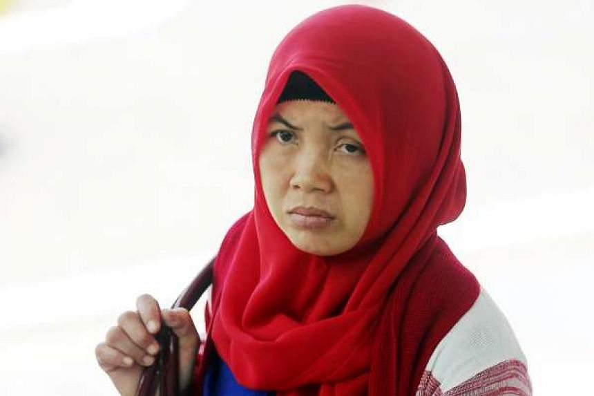 Indonesian maid Khanifah said she was hit with a hammer about five times and twice on the mouth during the second half of her employment in 2012.