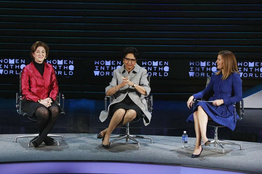 CEO of New America Anne-Marie Slaughter (left), CEO of PepsiCo Indra Nooyi (centre) and journalist Norah O'Donnell take part in a panel during the Women In The World Summit.