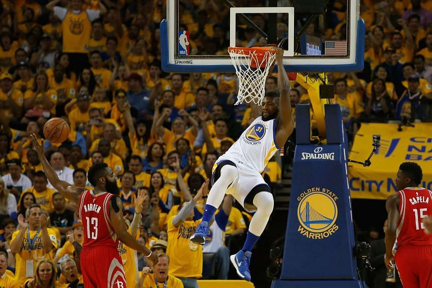 Festus Ezeli of the Golden State Warriors dunks the ball in the NBA Playoffs on April 18, 2016.