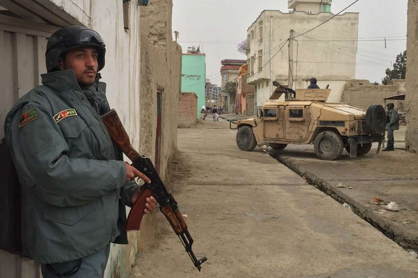 Security forces deployed around the Afghan Ministry of Defence during a gun battle with Taleban militants in Kabul on April 19, 2016.