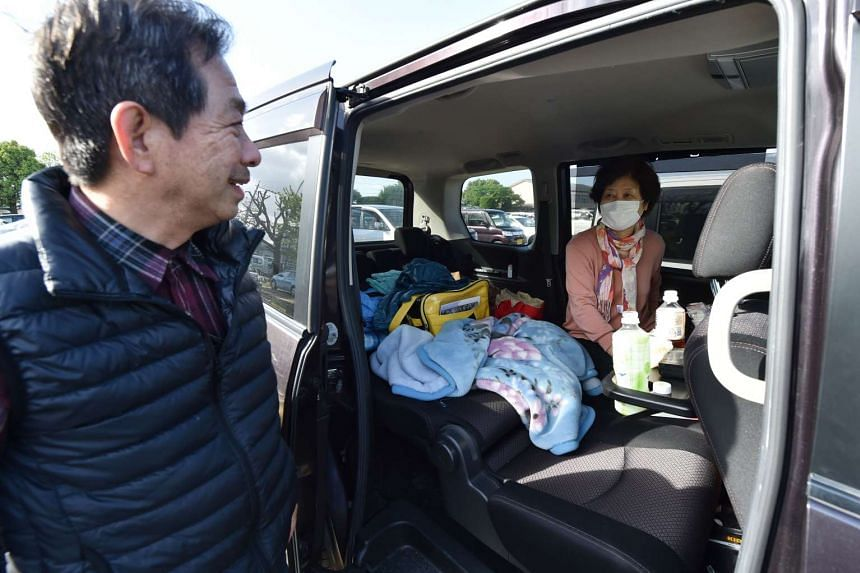 Evacuees who have been using their vehicle for shelter in Mashiki, in Kumamoto prefecture, following two major earthquakes.