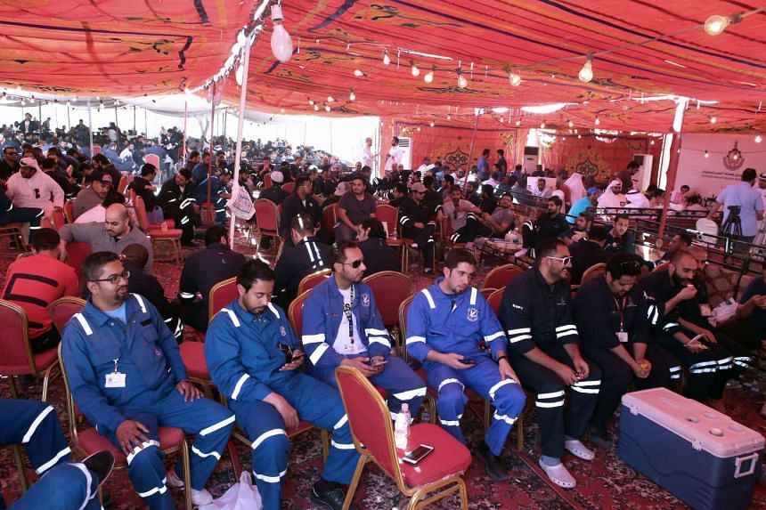 Kuwaiti oil workers sitting at the union's headquarters in Al-Ahmadi, 35km south of Kuwait City, on April 19, 2016.