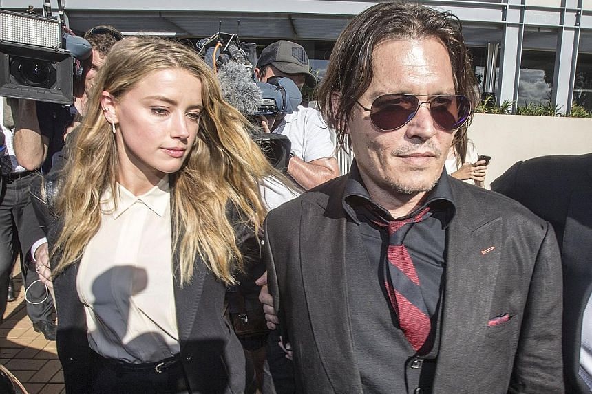 Johnny Depp and Amber Heard (both above) arriving at the Australian court. Heard pleaded guilty to falsifying travel documents to sneak two pet dogs into the country.