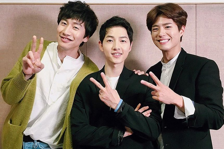K-drama heart-throb Song Joong Ki (centre) with his guests at the fan meeting, Lee Kwang Soo (left) and Park Bo Gum.