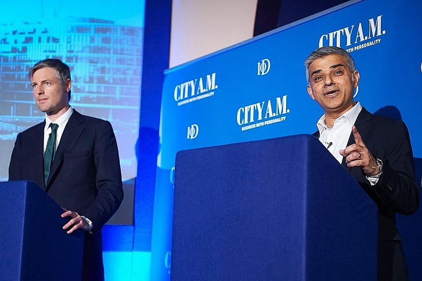 Conservative Party candidate Zac Goldsmith (left), who is from a prominent German-Jewish family, and Labour candidate Sadiq Khan, the son of Pakistani immigrants, at a mayoral debate in London last week. Mr Khan has said that electing a Muslim mayor