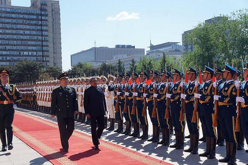 India's Defence Minister Manohar Parrikar with his Chinese counterpart Chang Wanquan at the welcome ceremony in Beijing on Monday. Mr Parrikar is on a five-day trip to China.