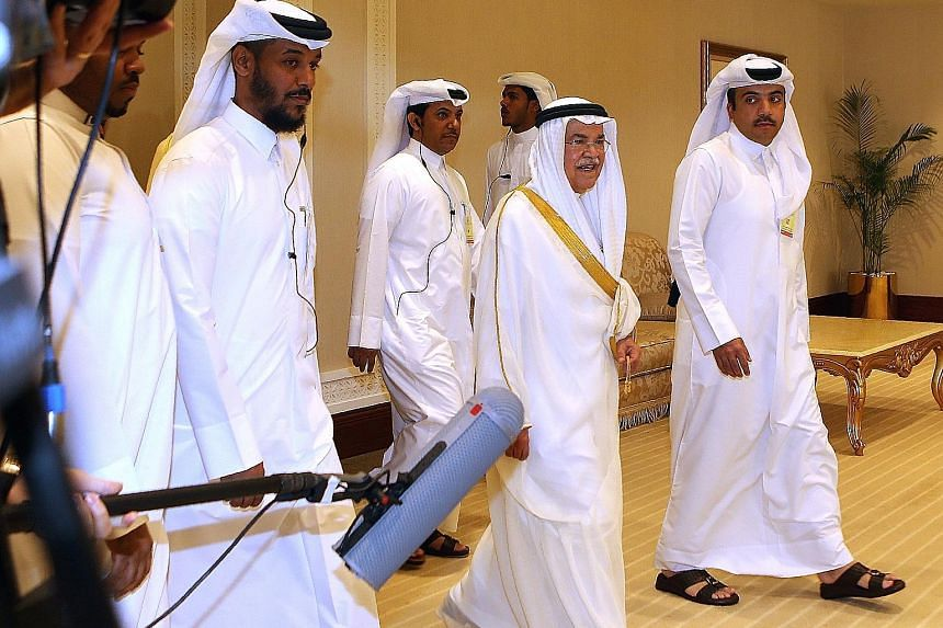 Saudi Arabian Oil and Mineral Resources Minister Ali al-Naimi (centre) arriving for the Opec meeting in Doha on Sunday. The collapse of the proposed output freeze leaves the world grappling with an excess of unwanted crude oil. Some analysts now beli