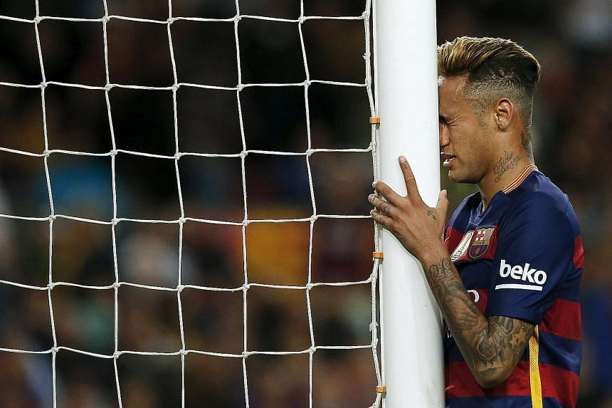 Neymar reacts after missing against Valencia, one of 22 attempts Barcelona had on goal in a match which they enjoyed 69 per cent possession. Still, the Spanish leaders can seal the title by winning their last five games.