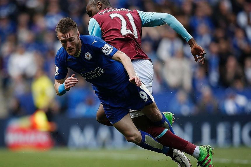 Leicester's Jamie Vardy going down in the box under pressure from West Ham's Angelo Ogbonna during their Premier League match at the King Power Stadium. Vardy was shown a second yellow card for simulation and will be suspended for Sunday's game again