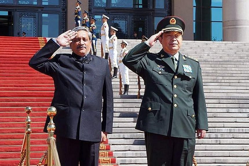Mr Parrikar (left) with his Chinese counterpart, Mr Chang Wanquan.