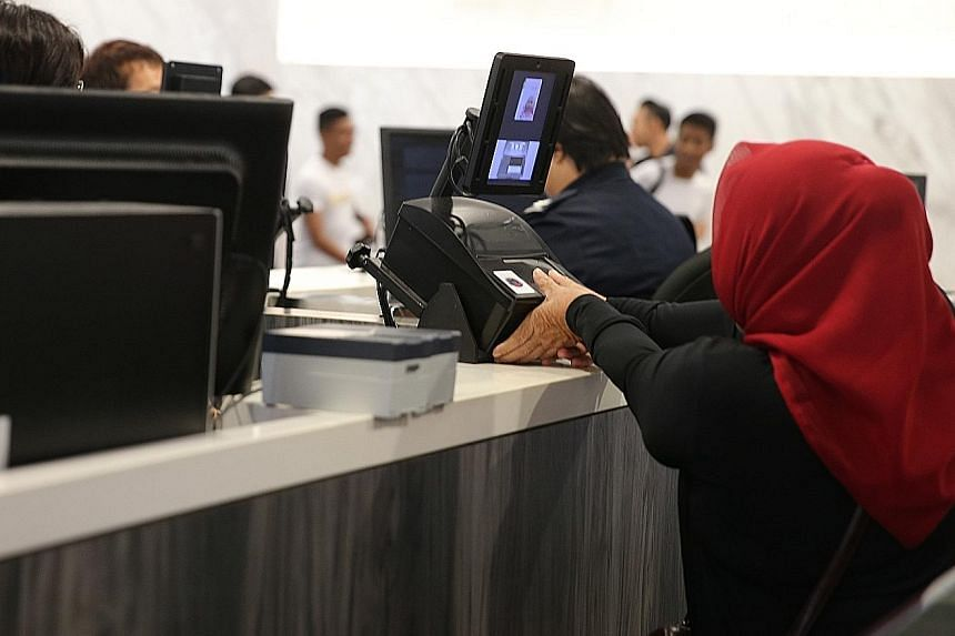 """The BioScreen system (above) will capture both thumbprints of a traveller. ICA noted that travellers may experience """"slightly longer immigration clearance times"""" with the implementation of the system."""