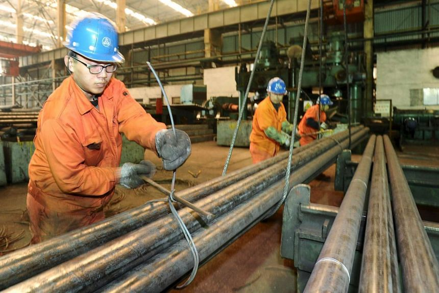 Employees work at a factory of Dongbei Special Steel Group in Dalian, China, on March 31, 2016.